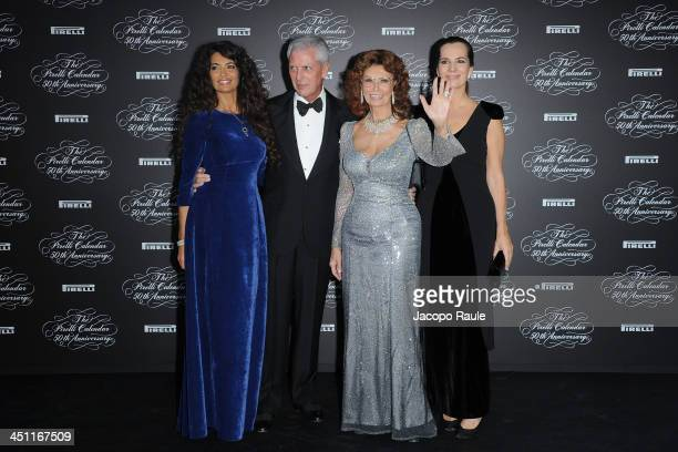 Afef Jnifen Marco Tronchetti Provera Sophia Loren and Roberta Armani attend The Pirelli Calendar 50th Anniversary Red Carpet on November 21 2013 in...