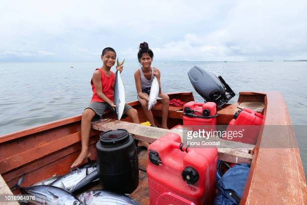 Afeina Faafe and her brother Takanauatu with the fish caught by their father overnight on August 15 2018 in Funafuti Tuvalu Fish are an important...