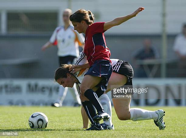 Aferdita Kameraj of Germany and Tina DiMartino of the USA battle for the ball during the friendly match between the Women's German Under 21 team and...