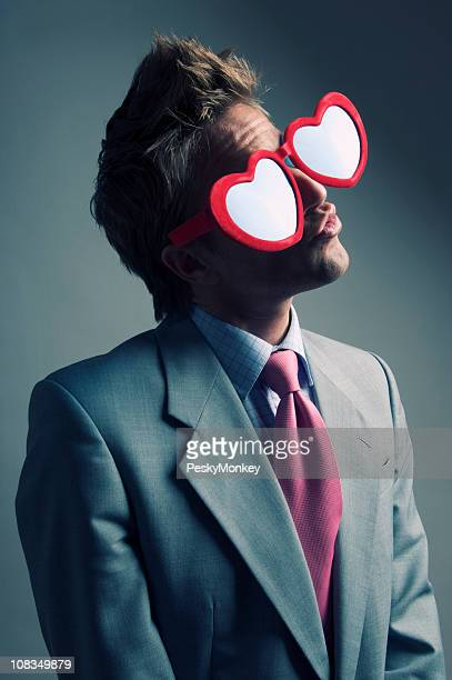 Affectionate Businessman w Heart Glasses Makes a Smoochy Face