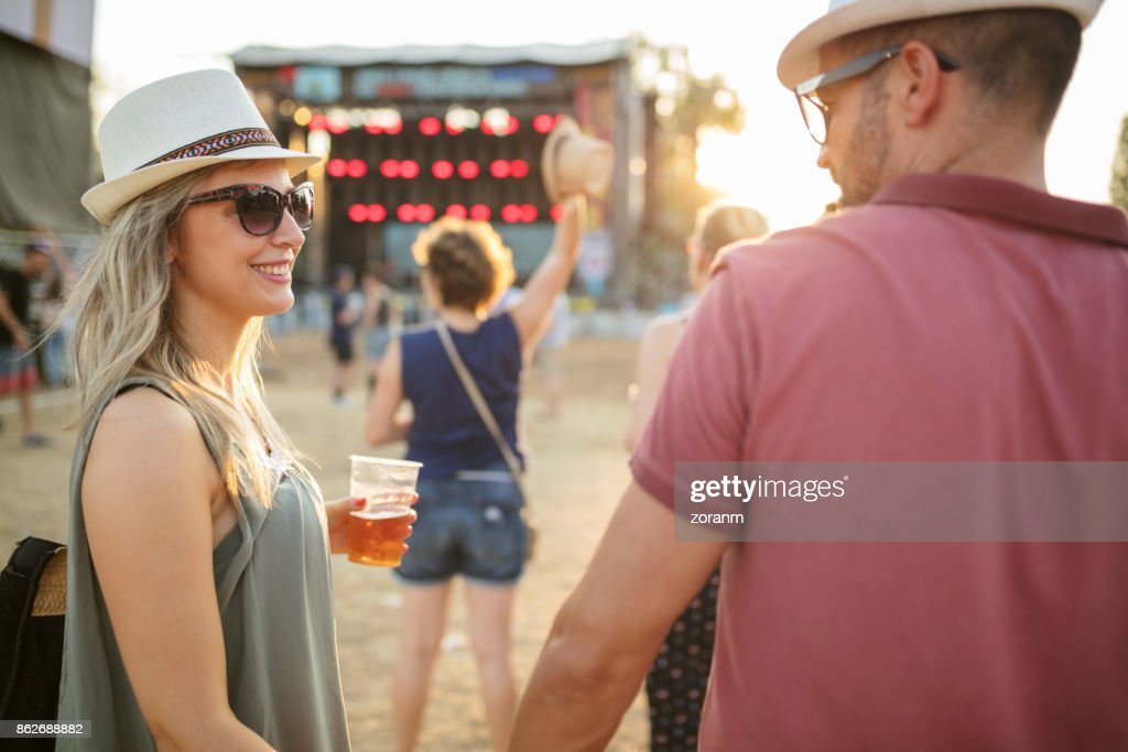 Affectionate couple at music festival : Stock Photo