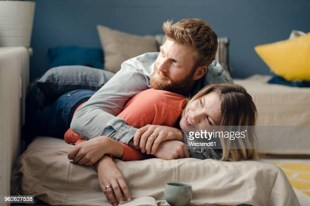 Affectionate couple cuddling at home