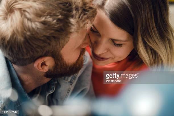 affectionate couple cuddling at home - liebe stock-fotos und bilder