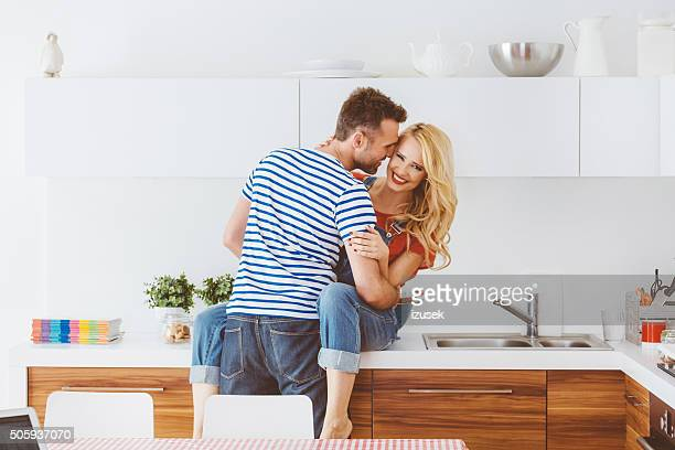 Affectionate couple embracing in a domestic kitchen