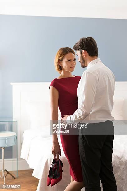 affectionate couple in bedroom - erotique chic photos et images de collection