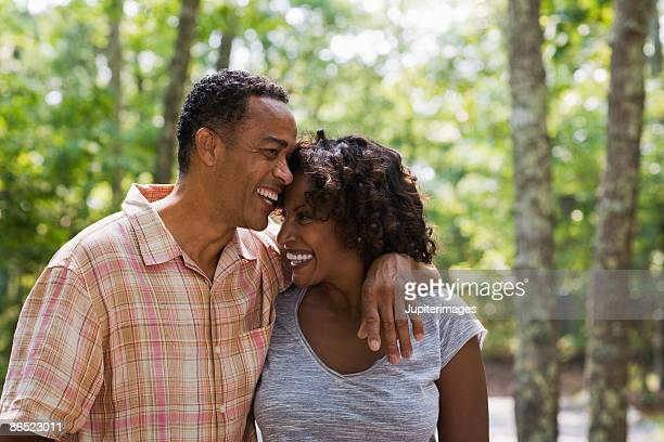 affectionate couple in woods - 45 49 years stock pictures, royalty-free photos & images