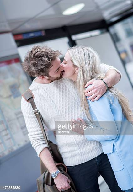 Affectionate couple kissing on the street