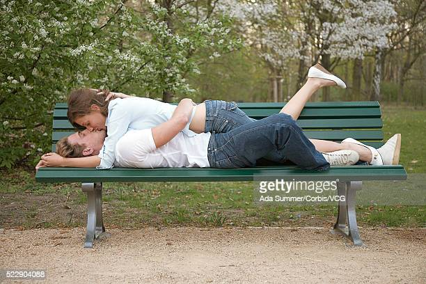 Affectionate couple on a park bench