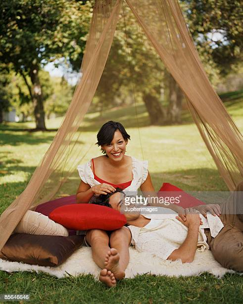 Affectionate couple under netting