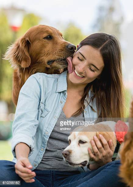 affectionate dog kissing a woman - licking stock pictures, royalty-free photos & images