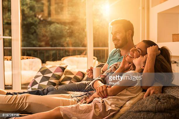 Affectionate family relaxing together in the living room.