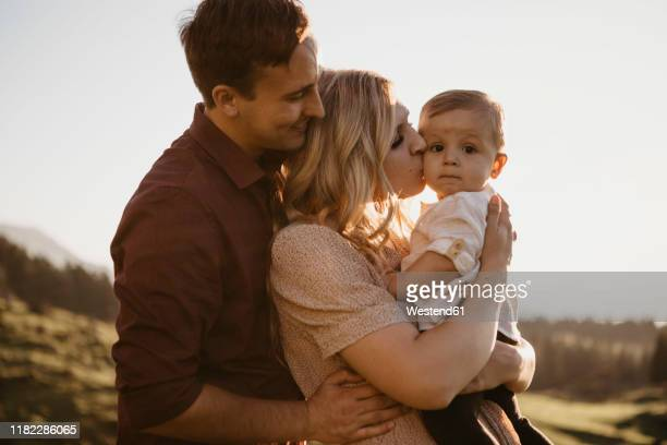 affectionate family with little son on a hiking trip, schwaegalp, nesslau, switzerland - young family stock pictures, royalty-free photos & images