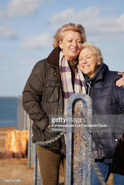 affectionate lesbian couple by sea - cef do not delete stock pictures, royalty-free photos & images