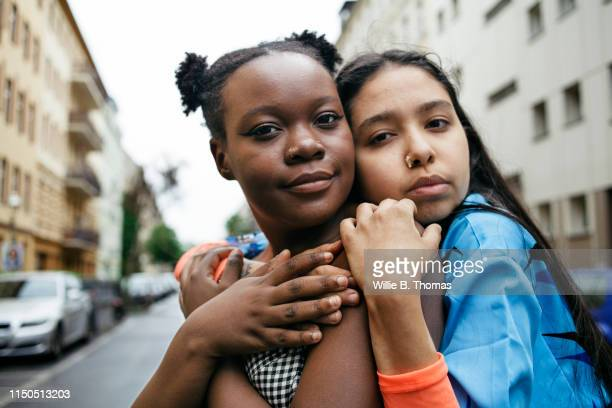 affectionate lesbian couple -  lgbtqi ストックフォトと画像