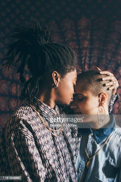 affectionate lesbian couple - kissing stock pictures, royalty-free photos & images