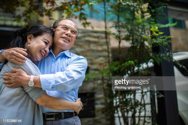 affectionate love between senior taiwanese couple - between stock pictures, royalty-free photos & images