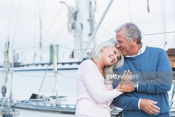 Affectionate mature couple at marina