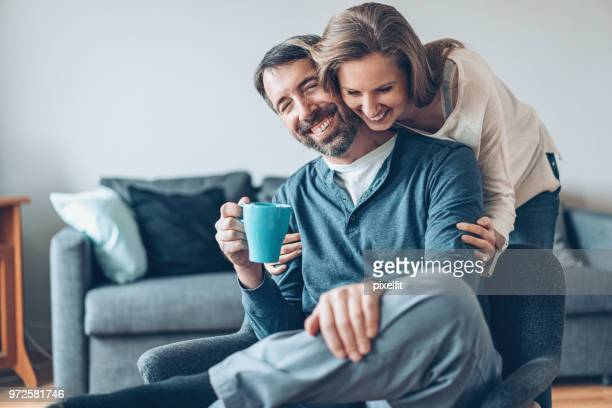 affectionate moment - mature couple stock pictures, royalty-free photos & images