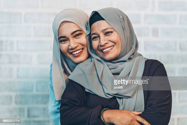 affectionate mother and daughter - muslim mother stock pictures, royalty-free photos & images