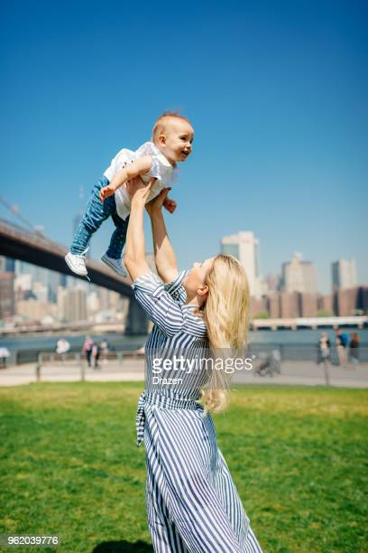 Affectionate mother playing with baby in New York City