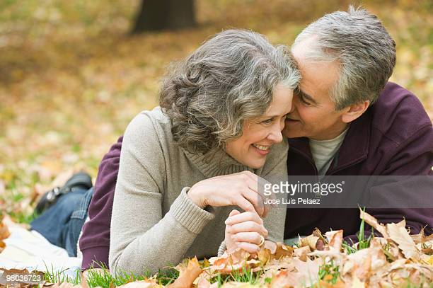 Affectionate older couple on the grass