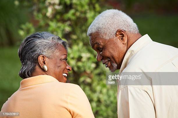 Affectionate senior African American couple looking in each othe