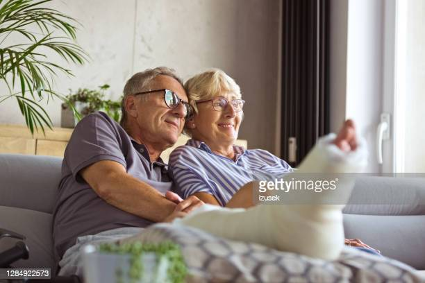 affectionate senior couple at home - senior women stock pictures, royalty-free photos & images