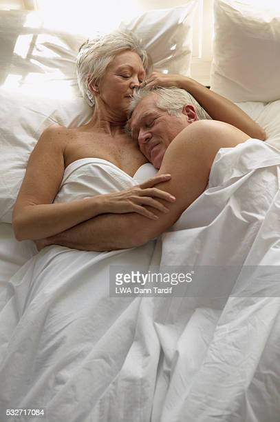 Affectionate Senior Couple in Bed