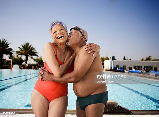 Affectionate senior couple poolside