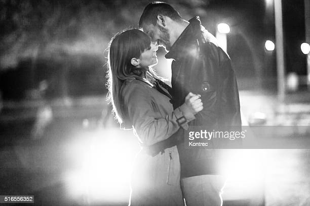 affectionate young couple at night - vehicle light stock photos and pictures