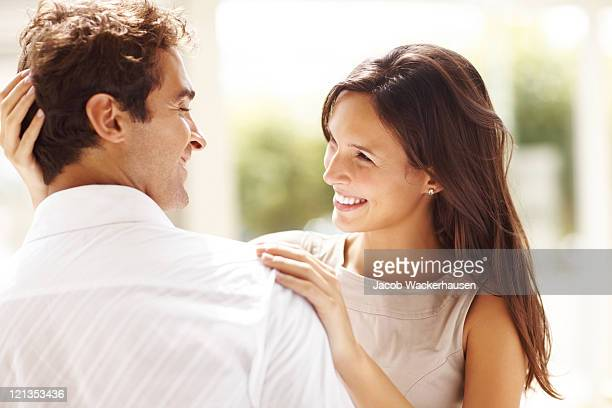 affectionate young couple looking at each other - falling in love stock pictures, royalty-free photos & images