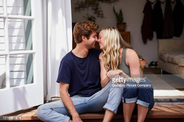 affectionate young couple relaxing on their patio at home - falling in love stock pictures, royalty-free photos & images