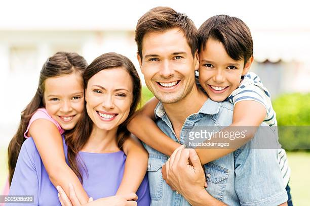 Affectionate Young Family Giving Piggyback Ride