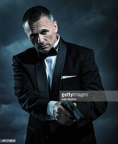 affluent bodyguard with handgun - secret agent stock pictures, royalty-free photos & images