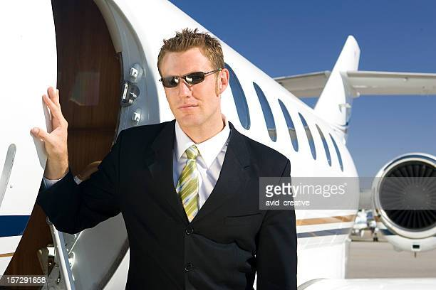 Affluent Travel-Businessman at Airplane Door