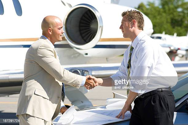 Affluent Travel-Businessmen Shaking Hands by Airplane