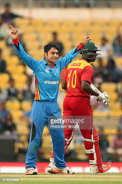 Afganistan's Rashid Khan celebrates the wicket of Zimbabwe's Vusi Sibanda during the T20 World Cup cricket match between Zimbabwe and Afghanistan at...