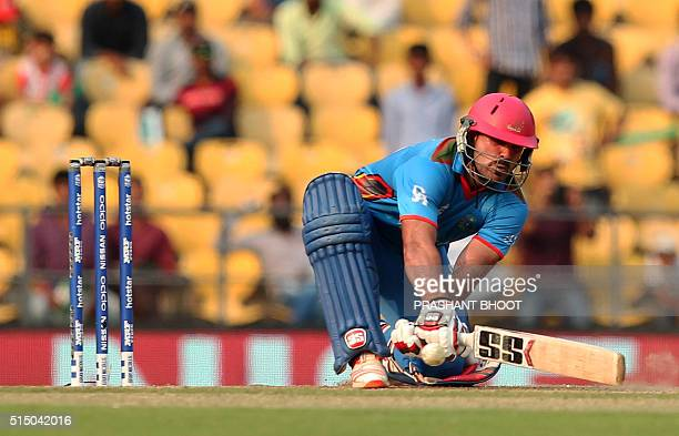 Afganistan's Samiullah Shinwari plays a shot during the T20 World Cup cricket match between Zimbabwe and Afghanistan at the VCA stadium in Nagpur on...