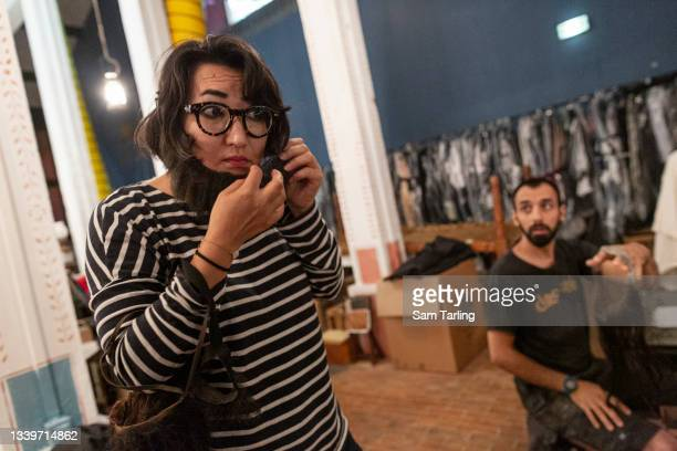 Afghan actor and artist Shakiba Dawod tries on a beard in the costume store at the Cartoucherie in Paris, France, on September 9, 2021 in Paris,...