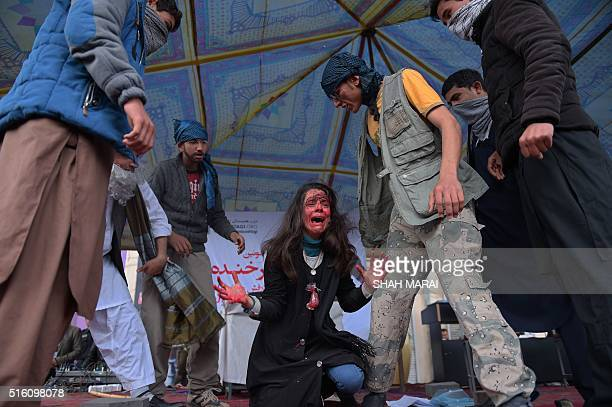 Afghan actors perform in a play depicting the 2015 lynching of Afghan woman Farkhunda in Kabul on March 17 2016 Farkhunda died on March 19 2015 after...