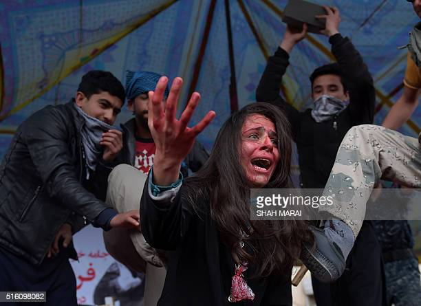 TOPSHOT Afghan actors perform in a play depicting the 2015 lynching of Afghan woman Farkhunda in Kabul on March 17 2016 Farkhunda died on March 19...
