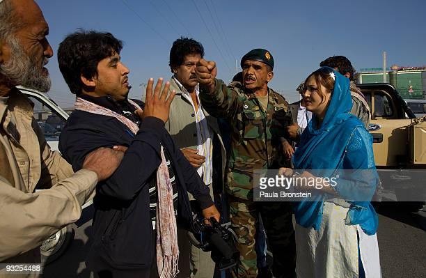 Afghan actress Trena Amiri watches as an Afghan National Army military policeman argues with the cameraman during the filming of the soap opera...