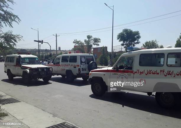 Afghan ambulances arrive at the site of an attack in Kabul on July 1 2019 Dozens of people were wounded with fatalities feared as a powerful car bomb...