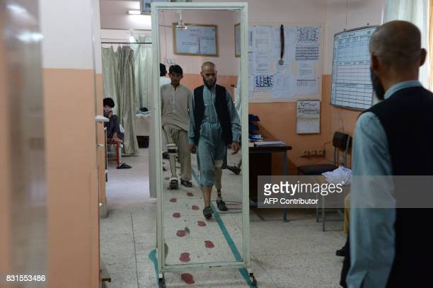 Afghan amputees walk with their prosthetic legs at a International Committee of the Red Cross hospital for war victims and the disabled in Jalalabad...