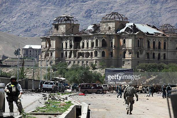 Afghan and foreign investigators inspect the site of a suicide car bomb attack on May 18 2010 in Kabul Afghanistan The Taliban attack targeting a...