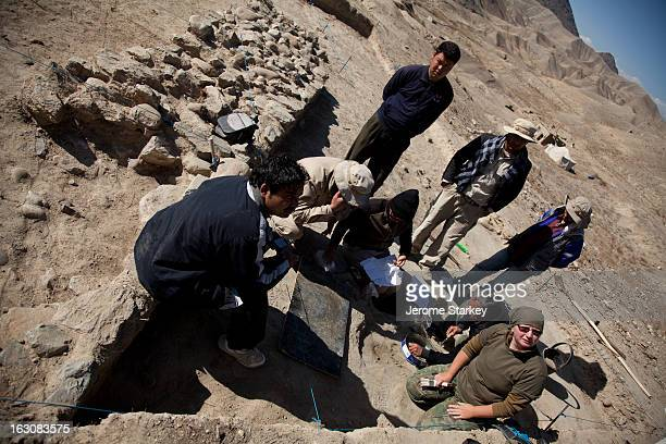 Afghan and international archeologists at the scene of a small hoard of gold and jewels, moments after they were unearthed at Mes Ainak, 35km south...