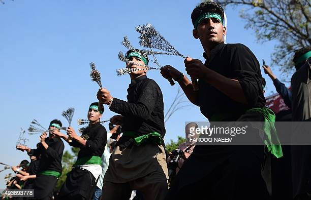 Afghan and Pakistani Shiite Muslims take part in an Ashura procession to commemorate the martyrdom of Imam Hussain the grandson of Prophet Muhammad...