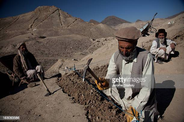 Afghan archeologists at breaking ground at Mes Ainak, an ancient copper mine, south of Kabul, Nov 14, 2011. More than 250 labourers were working with...
