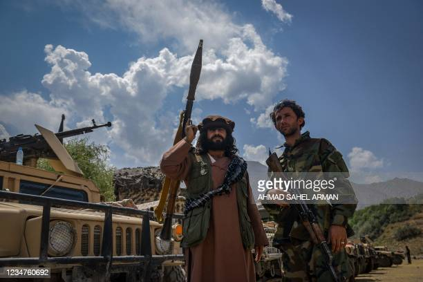 Afghan armed men supporting the Afghan security forces against the Taliban stand with their weapons and Humvee vehicles at Parakh area in Bazarak,...