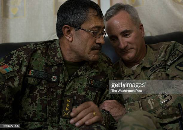 Afghan Army Colonel Abdul Sami Badakshani share a conversation with US Army Colonel Evan Trinkle on Saturday March 30 2013 at the Afghan Army camp...